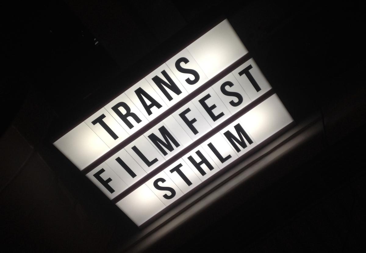 skylt med texten trans film fest sthlm